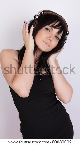 Cute sexy girl is listening music - stock photo