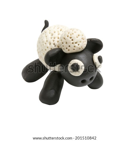 Cute sheep made by clay sculpting on white background - stock photo