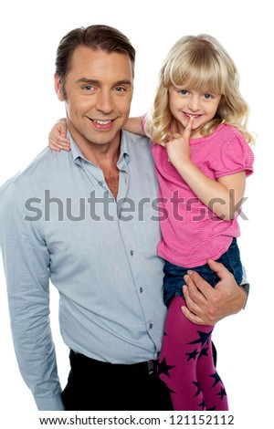 Cute shy little daughter being carried by her handsome father over white background. - stock photo