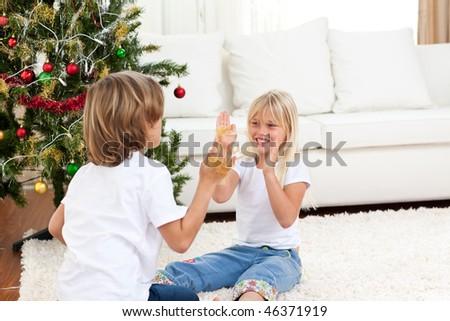 Cute siblings having fun at Christmas  at home - stock photo