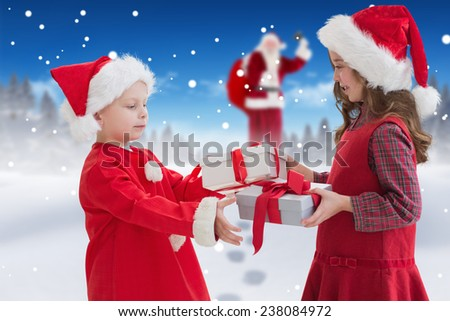 Cute siblings with gifts against bright blue sky over clouds - stock photo