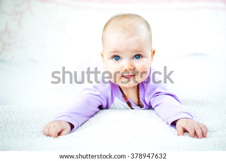 Cute six month old baby with blue eyes - stock photo