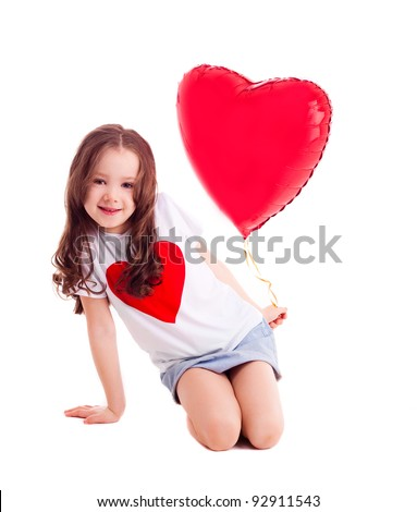 cute six year old girl  with a big red heart-shaped balloon, isolated against white background - stock photo