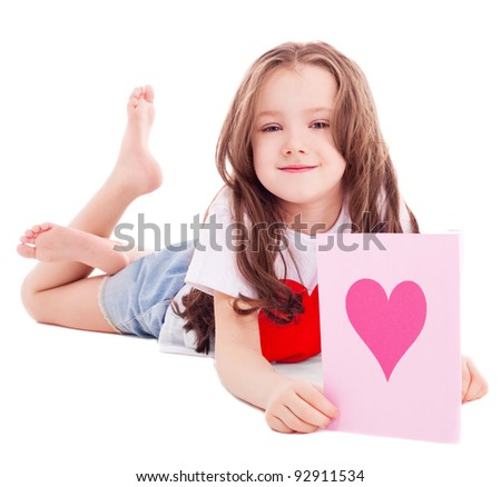 cute six year old girl  with a Valentine's card in her hands, isolated against white background - stock photo