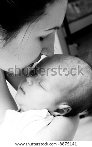 Cute sleeping baby 1,5 month in the hands of mother