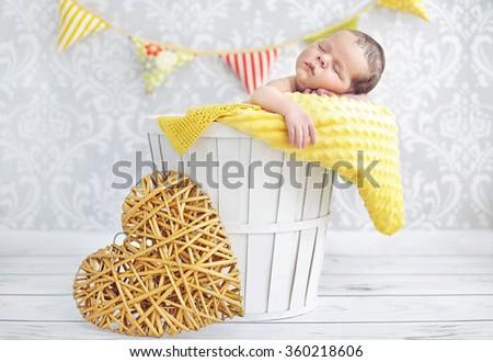 Cute sleeping newborn baby - stock photo
