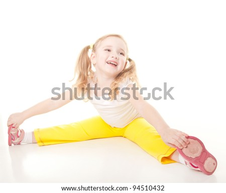 cute sly little girl doing gymnastic exercise - stock photo