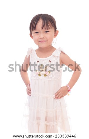 Cute small asian girl in white dress over white background.