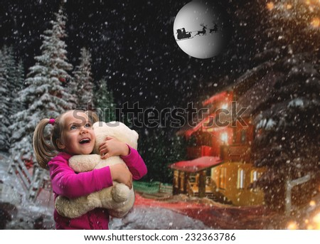 Cute small girl  with toy beart outside - stock photo