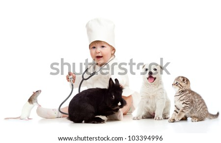 Cute small kid doctor examining pets dog, cat, bunny and rat - stock photo
