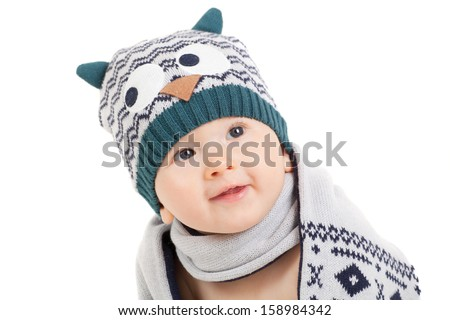 cute smiling baby with hat and scarf in studio - stock photo