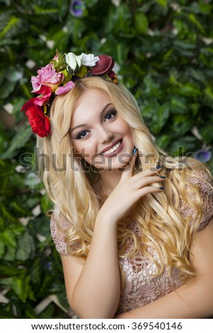 Cute smiling blond girl with circlet from flowers, close up shot - stock photo