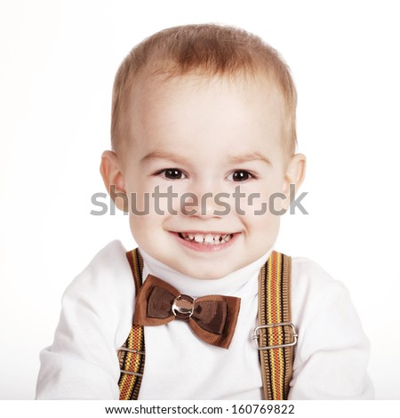 cute smiling boy with bow-tie on white - stock photo