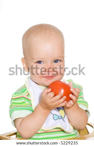 Cute smiling child with red tomato. Isolated over white - stock photo
