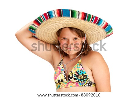 Cute smiling girl holding colorful Mexican hat on her head