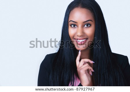 Cute smiling girl looking with interest - stock photo