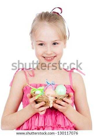 cute smiling kid girl holding Easter eggs in basket - stock photo