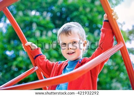 Cute smiling kid on playground - stock photo