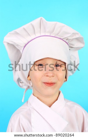 cute smiling little child dressed as a cook