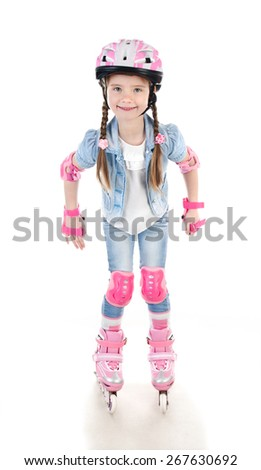 Cute smiling little girl in pink roller skates and protective gear isolated on a white - stock photo