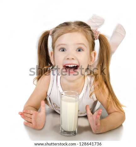Cute smiling little girl is drinking milk isolated over white - stock photo