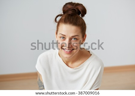 Cute smiling woman. Closeup portrait woman looking happy. Sitting on the floor and relaxing in the bedroom at the weekend. Positive human emotion facial expression body language. Funny girl - stock photo