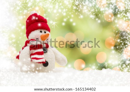 Cute Snowman Over Green and Gold Snow and Light Abstract Background. - stock photo