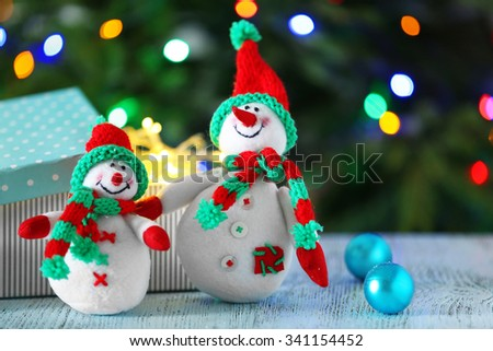 Cute snowmen on Christmas background - stock photo