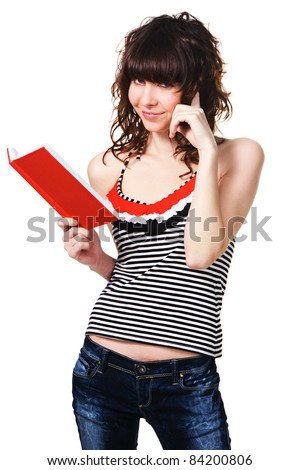 Cute student girl with a red book on white background