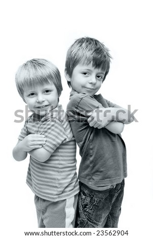 Cute studio portrait of two brothers. - stock photo