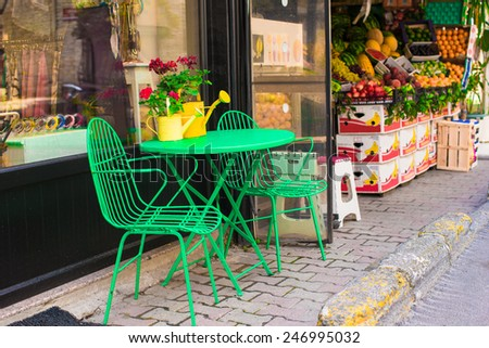 Cute summer empty outdoor cafe at tourist city - stock photo
