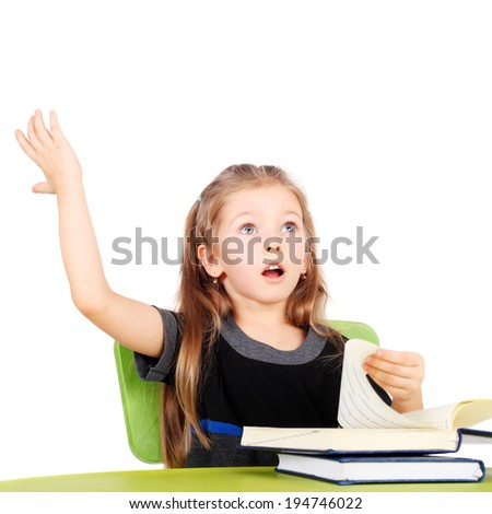 cute surprised little girl with the books - stock photo