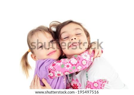 cute sweet little girls embracing - stock photo
