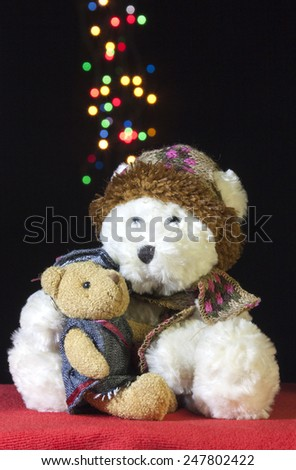 Cute teddy bears with colorful bokeh - stock photo