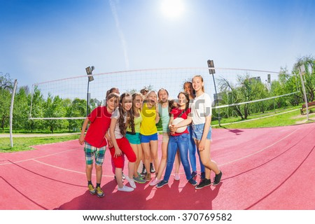 Cute teen boys and girls in volleyball team - stock photo