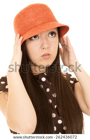 Cute teen girl model adjusting orange hat - stock photo