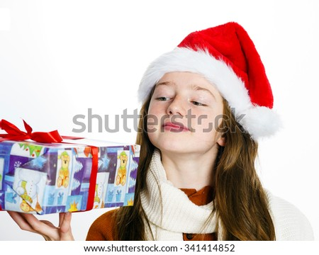 Cute teenage girl in santa red hat with gift box isolated on white, Christmas postcard