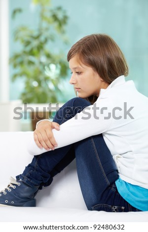 Cute teenage girl posing in front of camera - stock photo