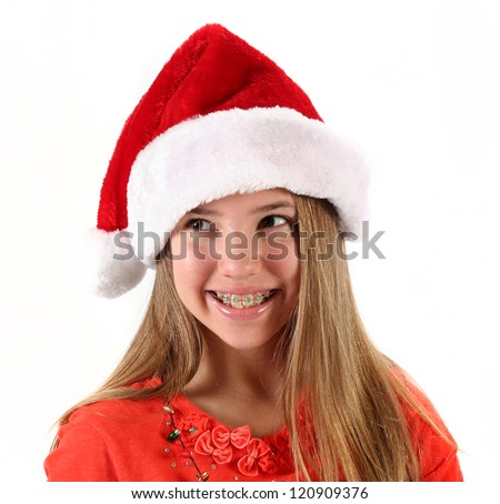 Cute teenage girl wearing Santa hat for Christmas on white background - stock photo