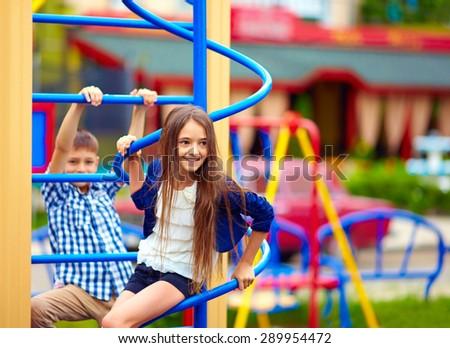 cute teenage kids having fun on playground - stock photo