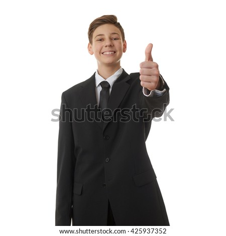 Cute teenager boy in back business suit showing thumb up sign over white isolated background, half body, future career concept - stock photo