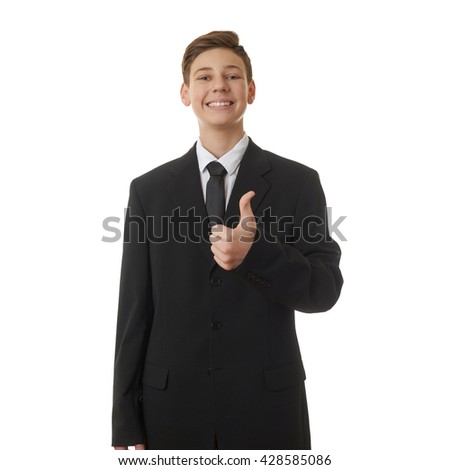 Cute teenager boy in back business suit showing thumb up sign over white isolated background, half body, future career concept