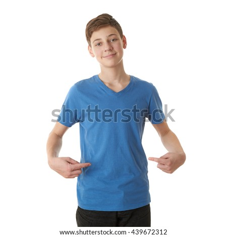 Cute teenager boy in blue T-shirt pointing himself over white isolated background, half body - stock photo