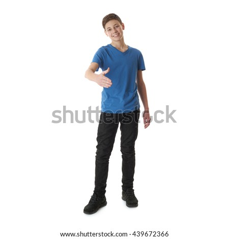 Cute teenager boy in blue T-shirt standing and greeting over white isolated background full body - stock photo
