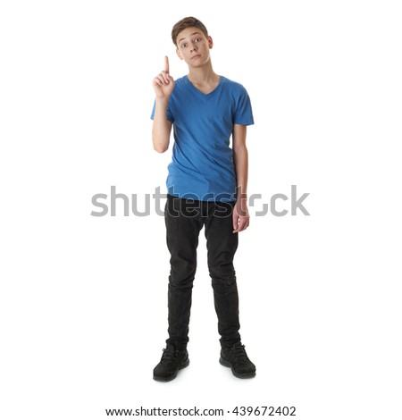 Cute teenager boy in blue T-shirt standing and pointing up over white isolated background full body - stock photo