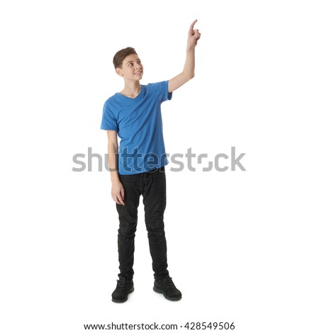 Cute teenager boy in blue T-shirt standing and pushing high button over white isolated background full body - stock photo