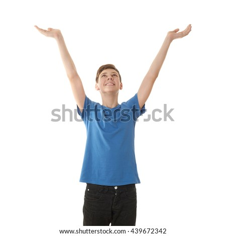 Cute teenager boy in blue T-shirt stretching hands up over white isolated background, half body