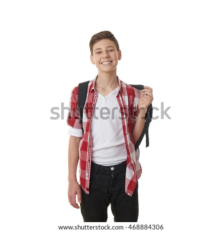 Cute teenager boy in red checkered shirt putting school bag on over white isolated background, half body, as school, education concept