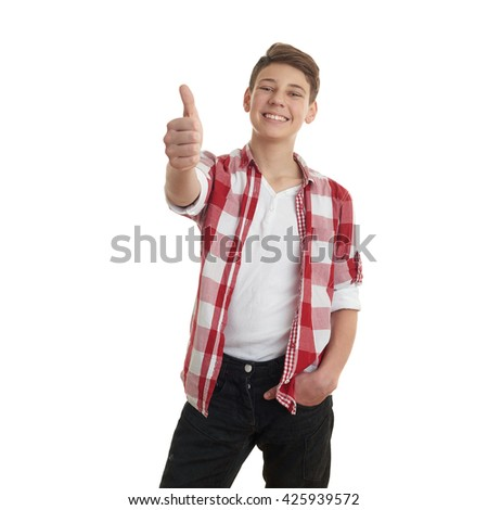 Cute teenager boy in red checkered shirt showing thumb up sign over white isolated background, half body - stock photo