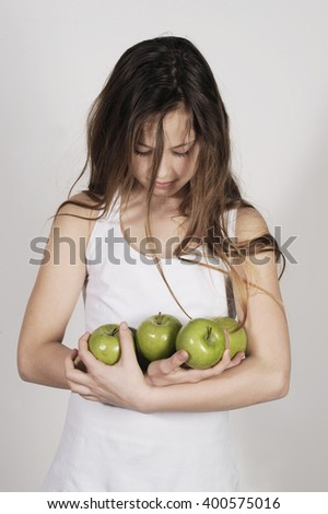 cute teenager holding fresh apples